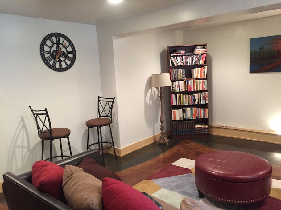 The other side of the living room...feel free to enjoy any of the books on the shelf during your stay