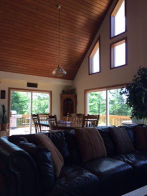 Comfortable open living area with cathedral ceilings and views of the lake.
