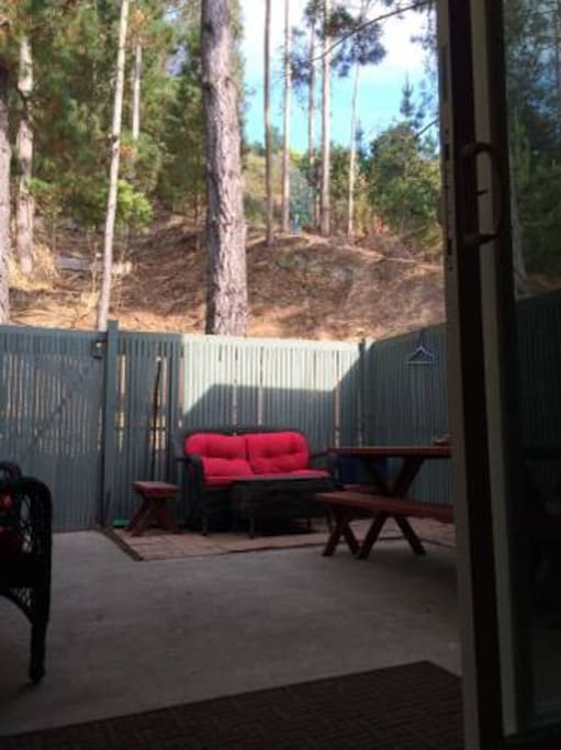 Peaceful patio opens up to a large wooded hillside and hiking trail...very serene.  Smoking ok outside.