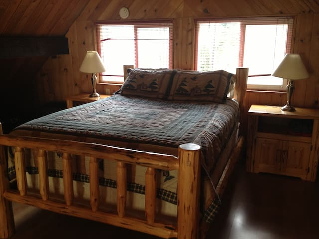 The log bed in the loft offers a great view of the river for the perfect wake up.