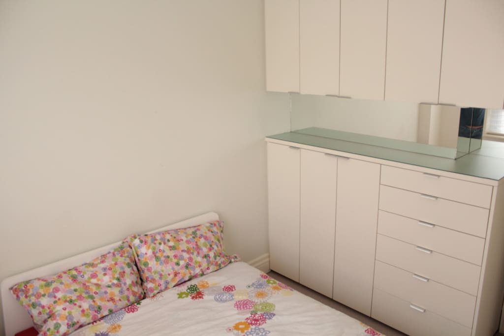 Separate bedroom with queen size bed and built in cabinets
