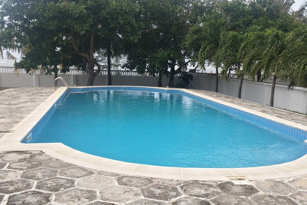 The huge private swimming pool provides a refreshing time for family and friends to enjoy and entertain privately.