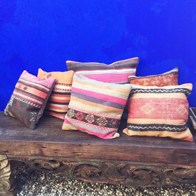 Vintage kilim pillows from Turkey and Morocco to lounge with outside on the patio.