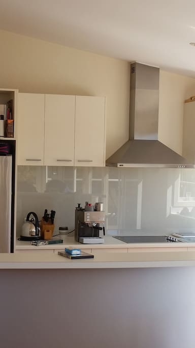 Clean kitchen, coffee machine and everything you need