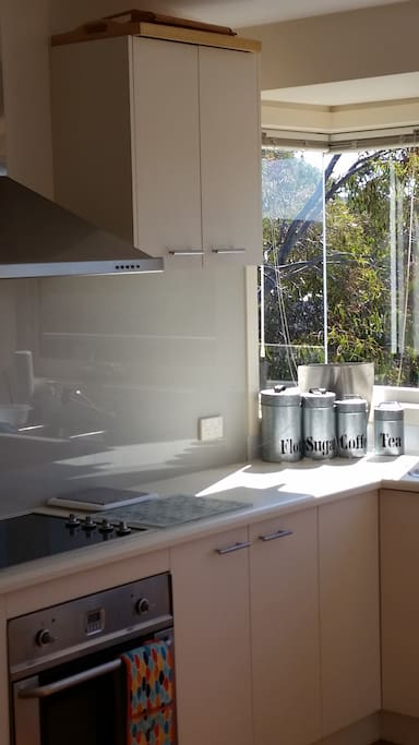 Sun soaked kitchen looking out over hills