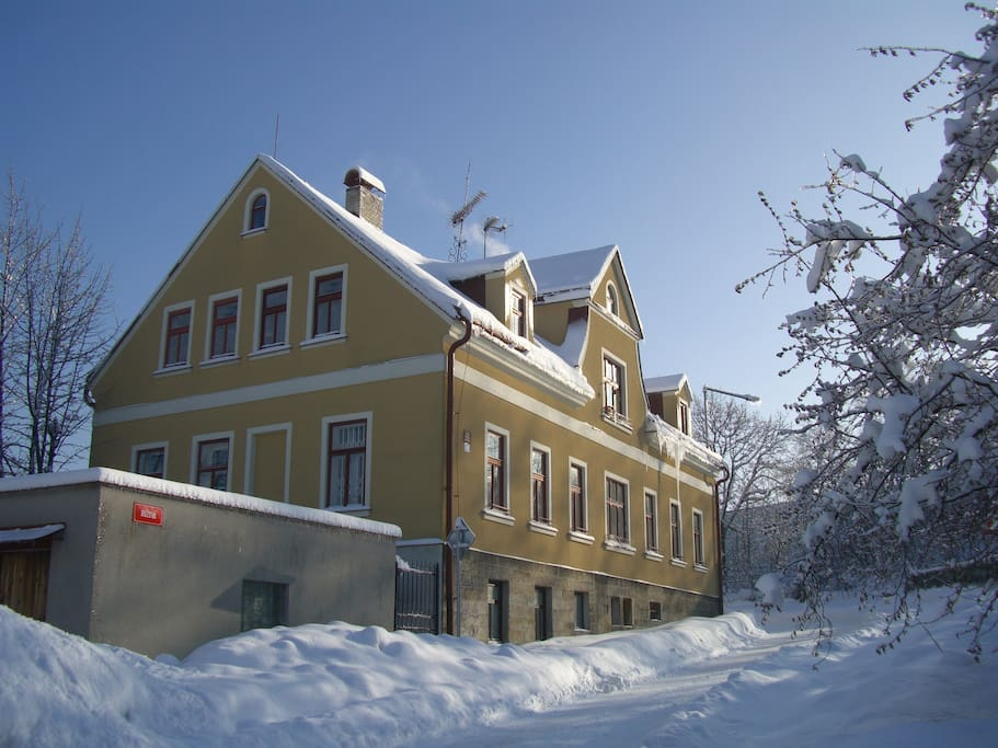 Winter view of Pink Street House. Skiing resorts are within a short distance by car, bus or train, around the town of Jablonec.
