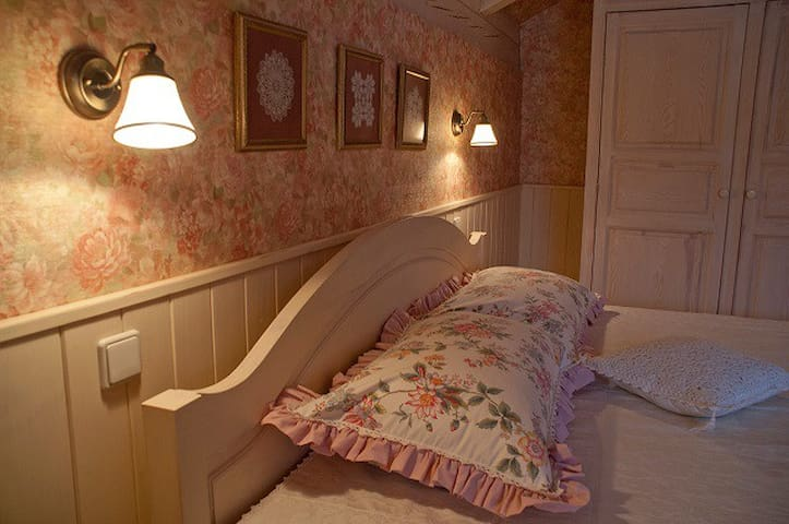 Ivory bedroom features small collection of antique hand-made doilies from the Budapest flea-markets:)