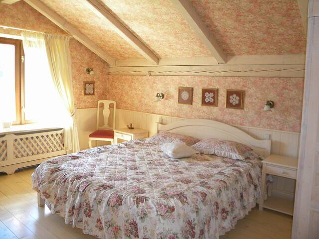 Ivory bedroom: a large double bed, own bathroom and a sofa-bed in a small attached room - good for a family with small kids