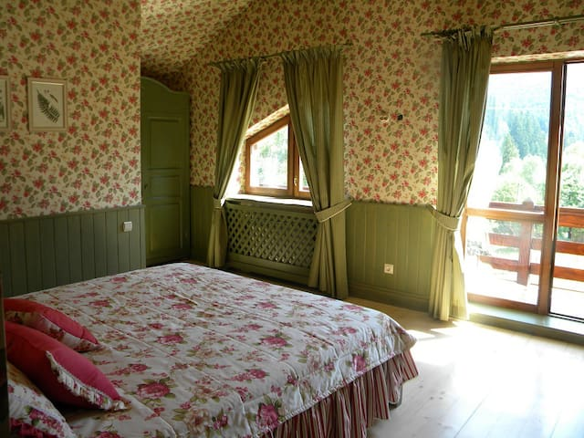 Sunny green bedroom faces South-East