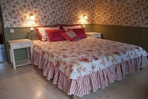 Green bedroom: large double bed, own bathroom and a balcony with a mountain and village view