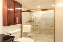 Bathroom: Wide-angle view of Walk-In Shower with Floor-to-Ceiling Tile