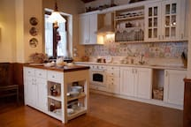 Kitchen is equipped with electric oven and stove, electric cattle, utencils, cutlery, pots and complete tableware set for 10