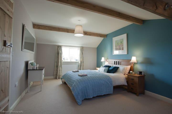 The stylish, spacious master bedroom ensures a good night's sleep.