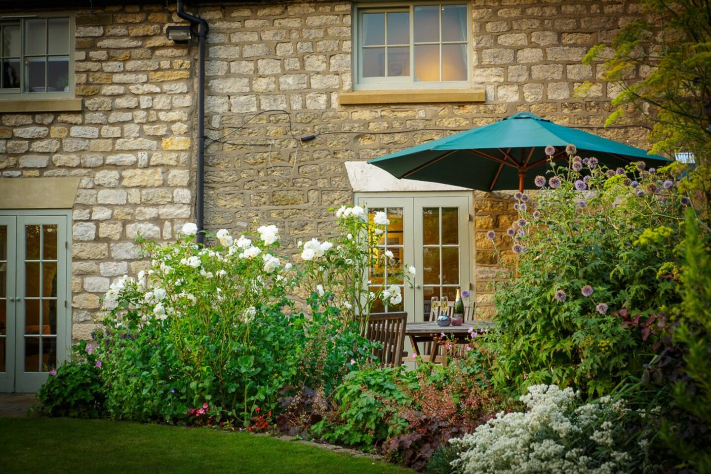 Enjoy a glass or two of fizz on the patio. Overlooking the private, secure, south facing cottage garden