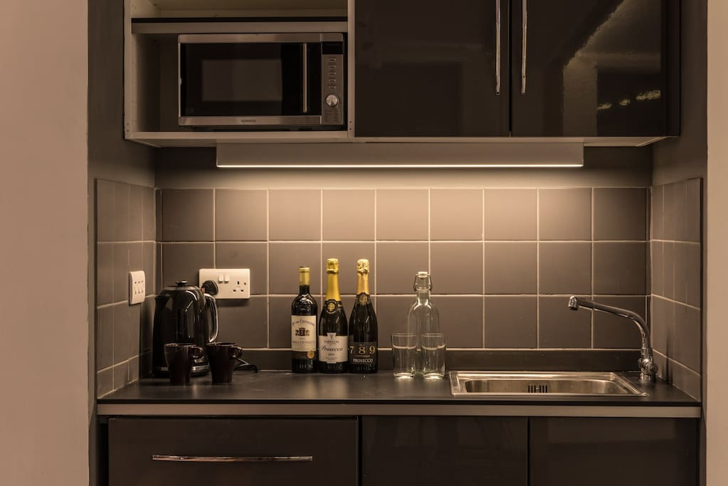 The kitchenette has a mini fridge, microwave and dishwasher.