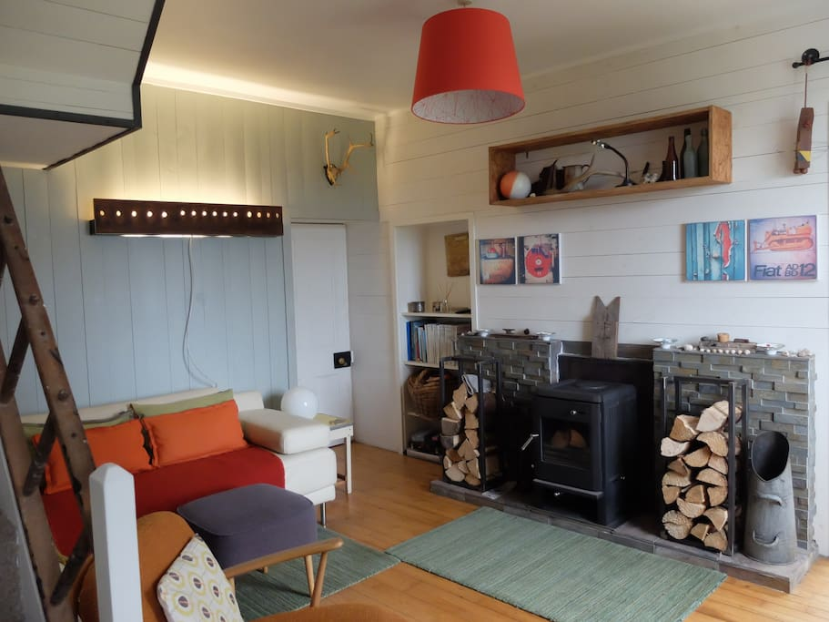 Open plan living room with wood burning stove