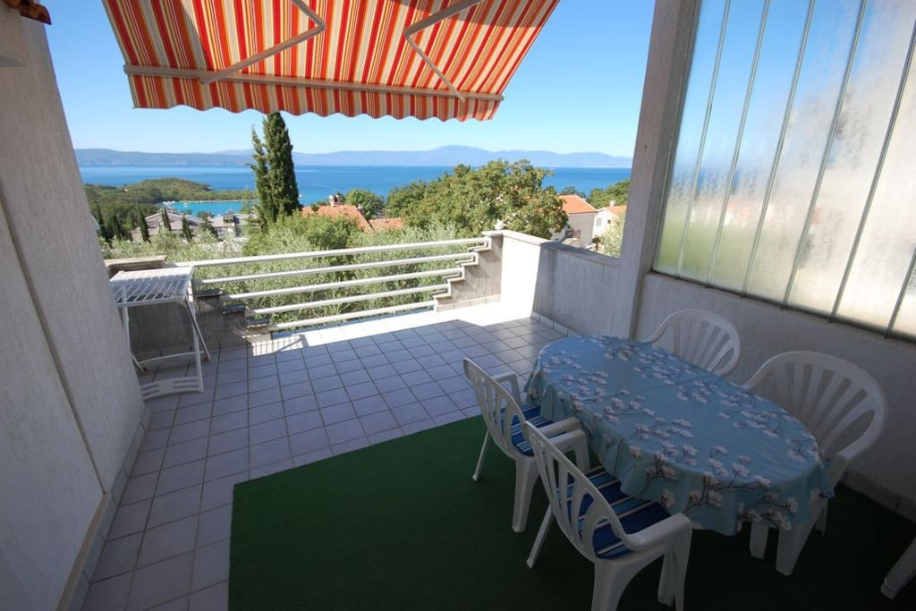 Balcony in shade with a garden furniture