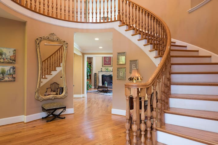 A dramatic 80' foot view axis through the rotunda to the family room fireplace greets you on entry.