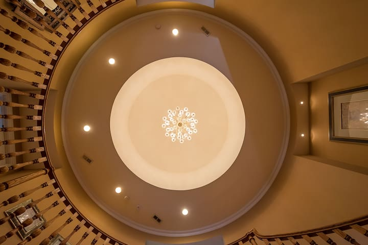 As you step into the rotunda or center of the home, you look up to see a dome with a 42 light European lead crystal chandelier.