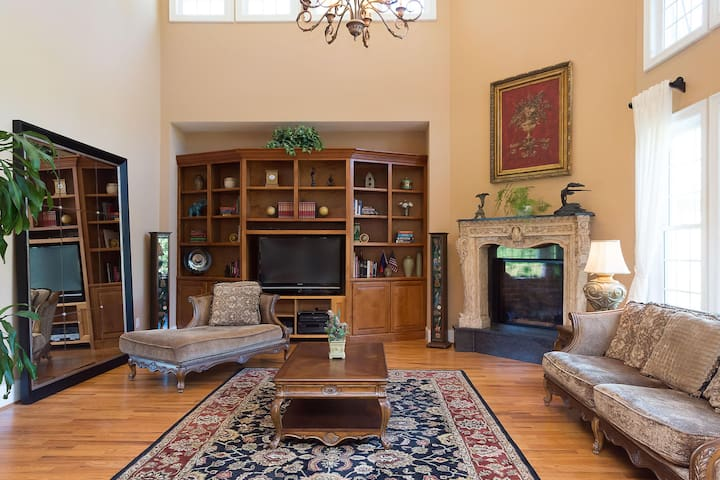 Family room with a Victorian mantel and a gas fireplace.