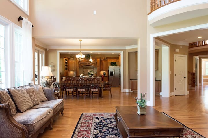 The convenient circular floor plan provides easy access to the den and formal living room, while connecting the kitchen and formal dining via the butler's pantry. There is a Romeo & Juliet balcony slightly visible at the top right part of this picture.