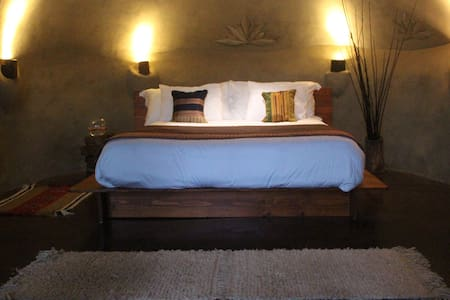 Room type: Private room Bed type: Real Bed Property type: Earth House Accommodates: 2 Bedrooms: 1 Bathrooms: 1