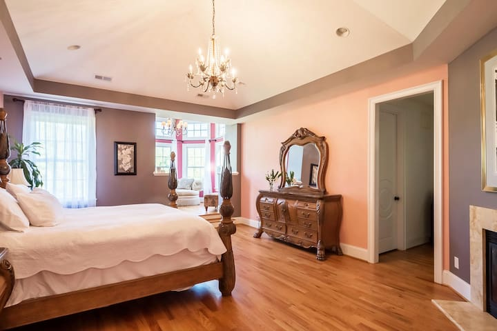 Camia Room, the master bedroom from front door has elegant trey ceilings, gas fireplace and a sitting area.