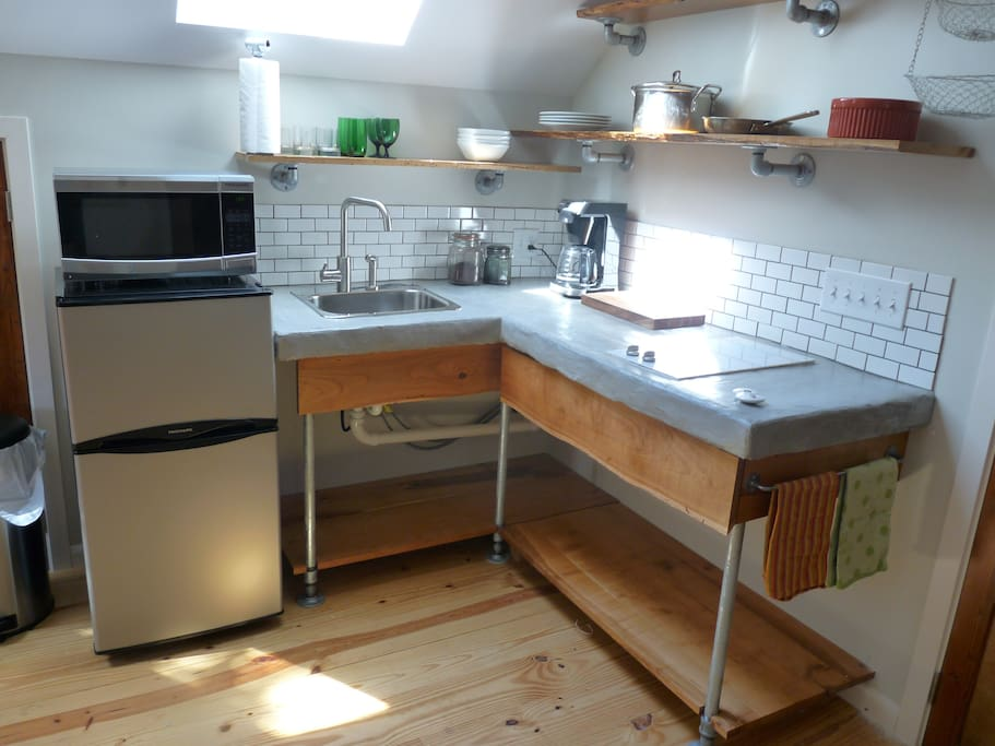 Kitchen, 2 burner cooktop, fridge, microwave, toaster, coffee maker, glassware, silver, etc.