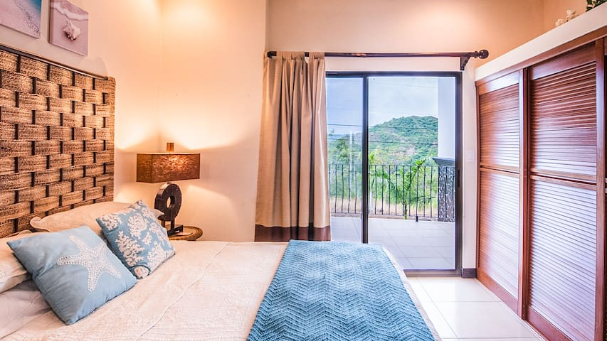 Second bedroom has a comfortable queen bed, large closet and private patio facing mountains.