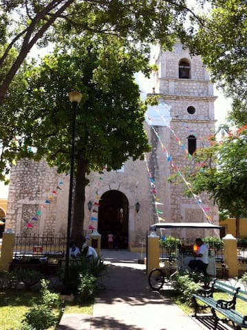 """La Iglesia de San Sebastián, in a beautiful park and lively just 3 blocks from our door. With good eats, a softball field, soccer and basketball courts, exercise equipment and free weeknight Zumba, this park really has it all! """"The location is ideal, close to the airport and a short walk from the center."""" --Will"""