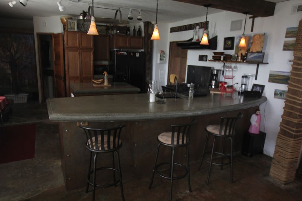 Kitchen with concrete counter tops
