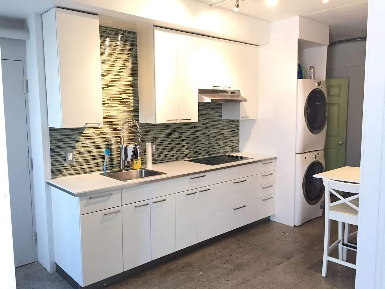 Clean and simple kitchen with full size laundry. Also cutlery and dishes if you prefer to eat in