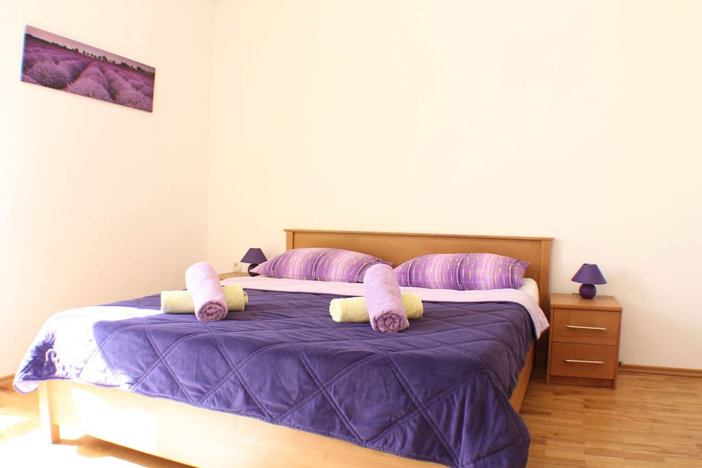 Private bedroom with double bed, flat screen tv and plenty of storage space.