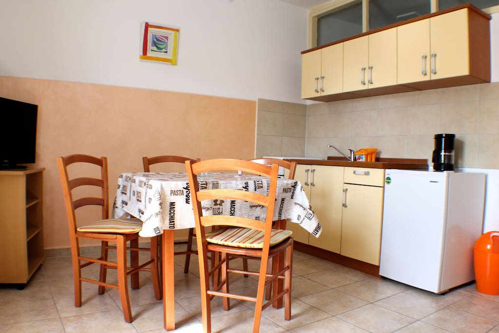 Living room and kitchen with flat screen tv and all you need for a pleasant stay.