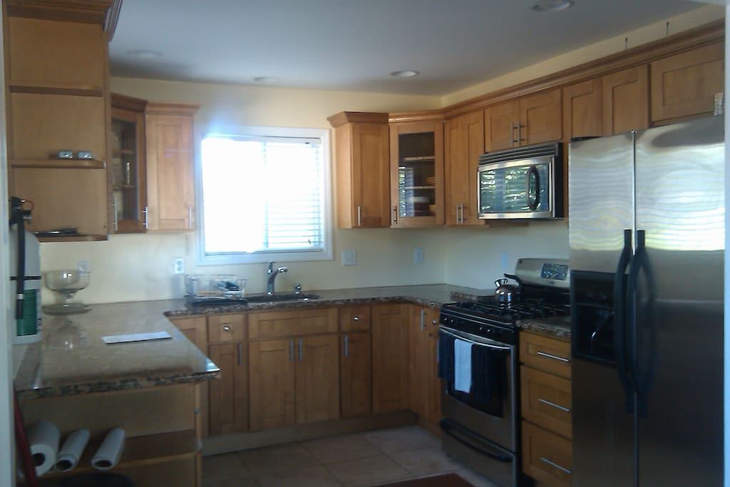 Updated Kitchen with Granite Countertops, Stainless Steel Appliances and Travertine Floors.