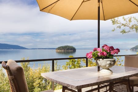Here's a beautiful northwest-style waterfront home on Chuckanut Bay. Panoramic windows, a full designer kitchen, built-in sound system, a big patio, and instant beach access.