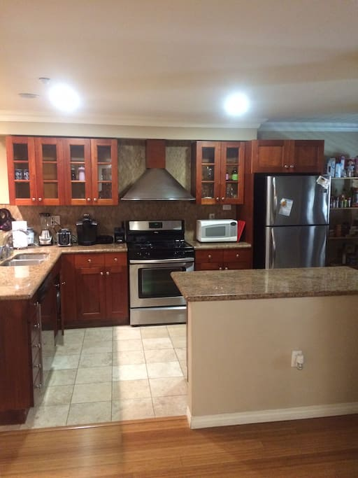 Chef's kitchen with island granite countertops, great for cooking and entertaining.