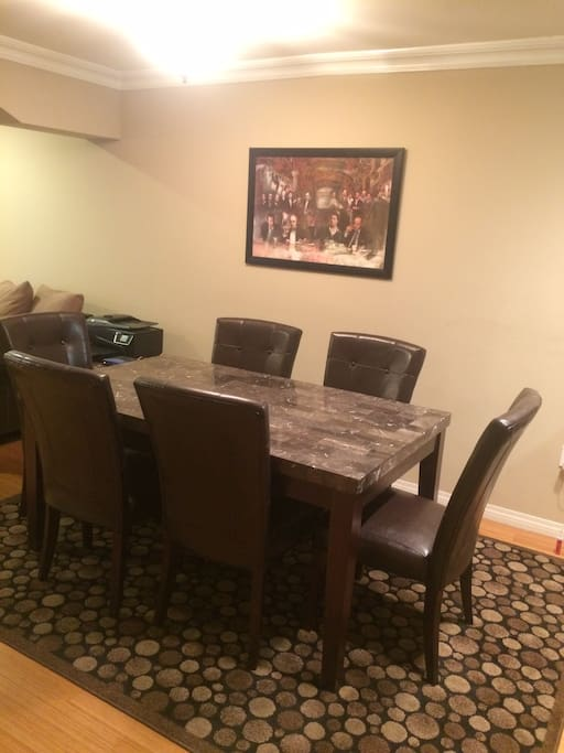 Granite top dinning room table with leather chairs.