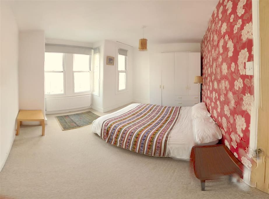 Spacious double large double bedroom, with a double bed and lots of storage space.  There's a desk and small sofa not shown in picture.