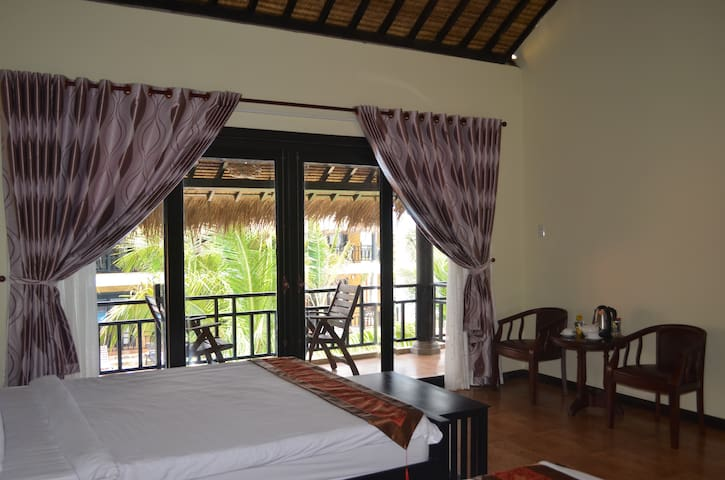 Second floor bungalow is spacious with the high ceiling coco palm roof style