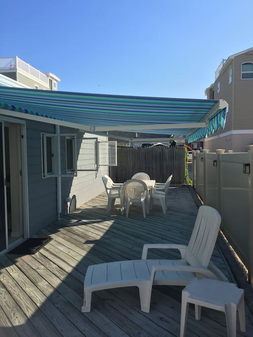 Side patio with cheerful awning