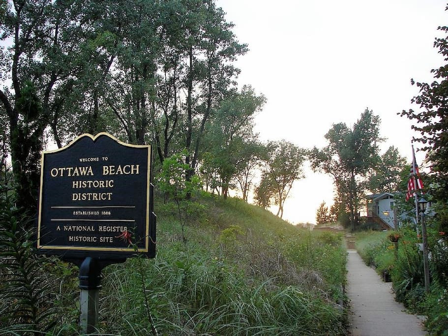 Stroll 10 minutes through the historic Ottawa Beach cottage community on your way to the sugar sand beaches and spectacular sunsets of Lake Michigan