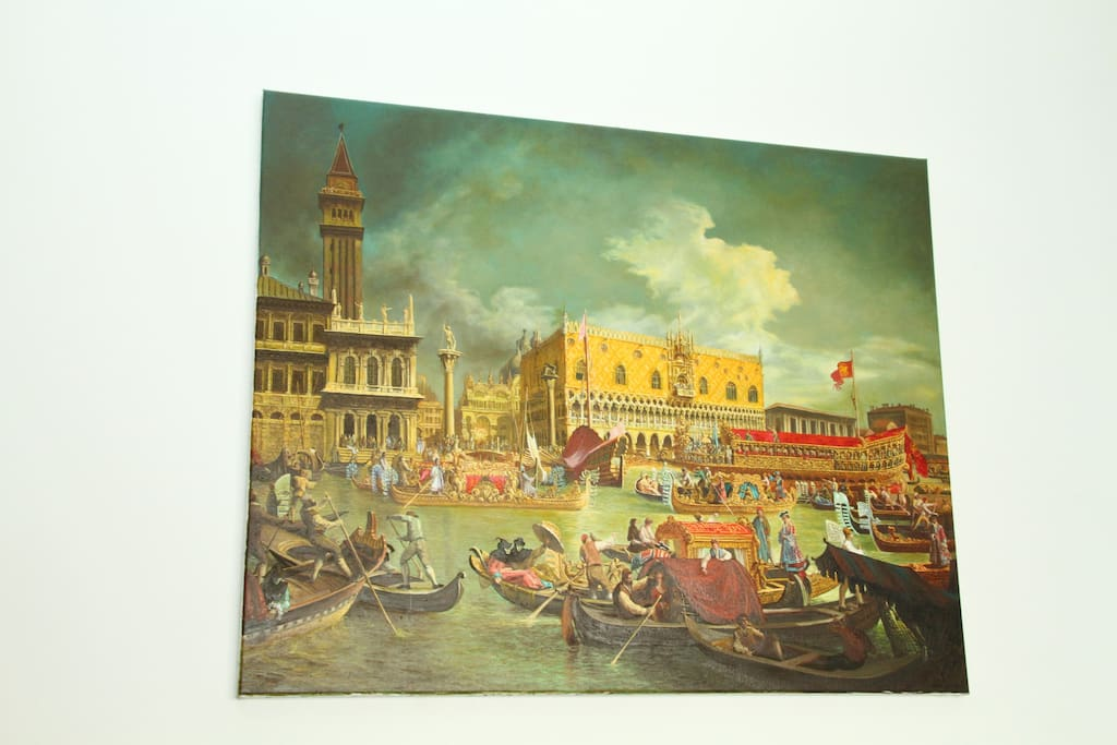 Large size oil painting of Venice during Carnival (a-la-maniere de Canaletto) on the wall of the spacious living