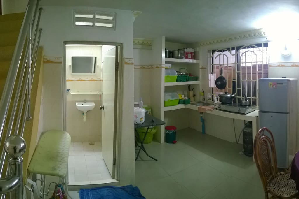 Kitchen with table & chairs. One of two shared shower/toilets.