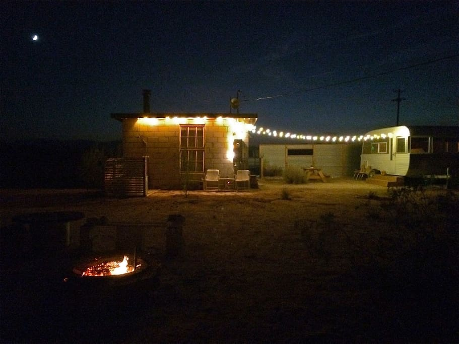 fire with moon over The Jackalope Compound
