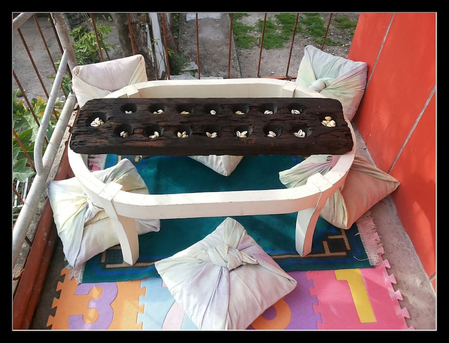terrace with sungka,  a filipino traditional boardgame.