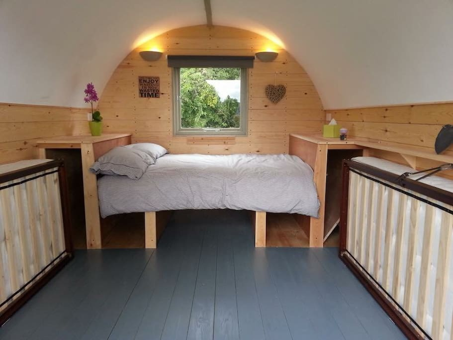 Double bed and bedding - also folds into table and bench.