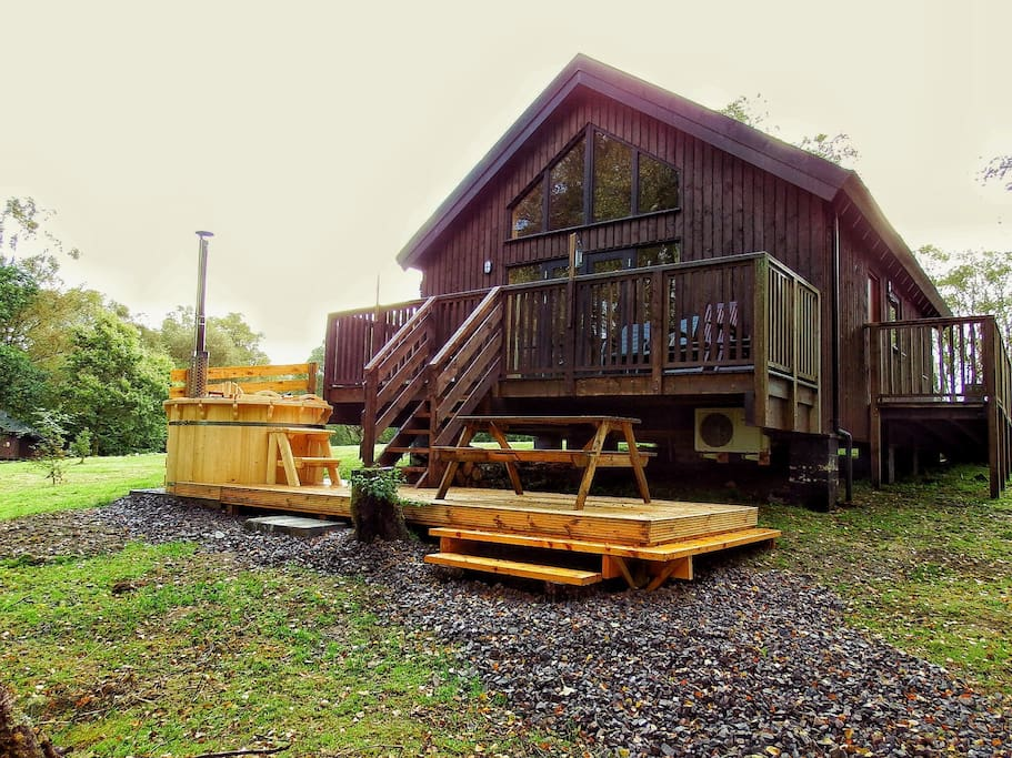 Lovely log cabin with hot tub houses for rent in Log cabins with hot tubs scotland