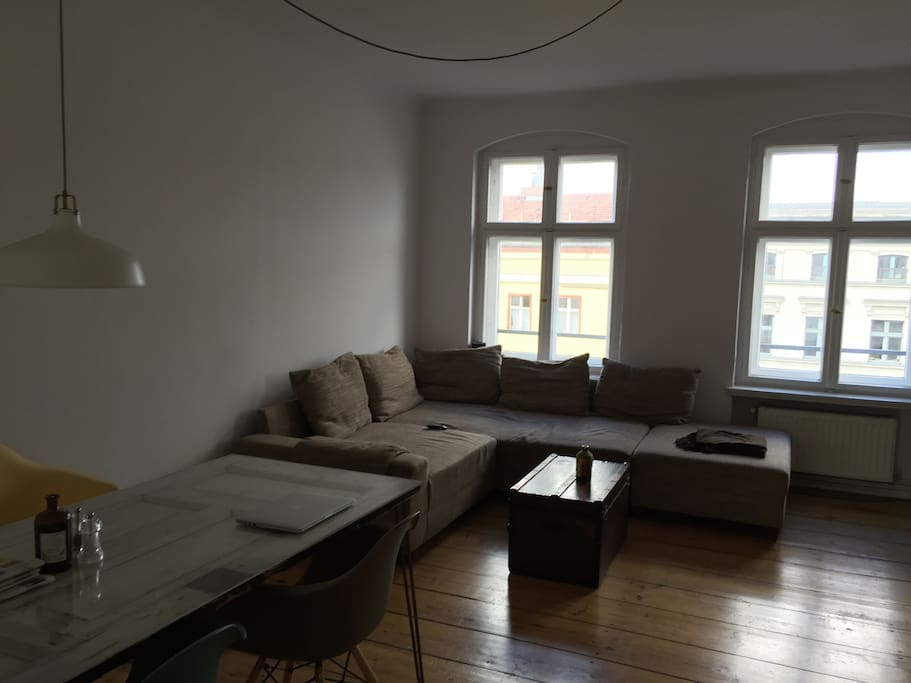 Living room with couch and dining table.