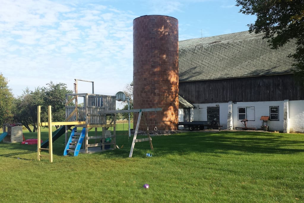 Playset against a backdrop of an old family farm.